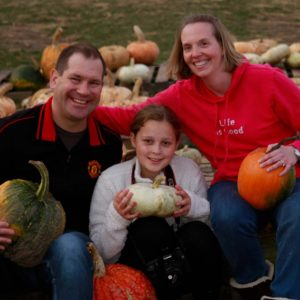A trip to the pumpkin patch with our friends' daughter