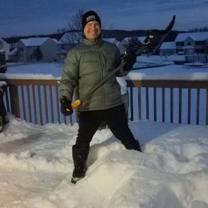Michael shovels the deck after a Syracuse snowstorm