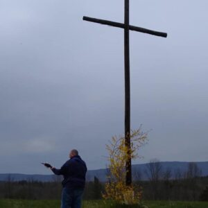 Leading worship at the Cross