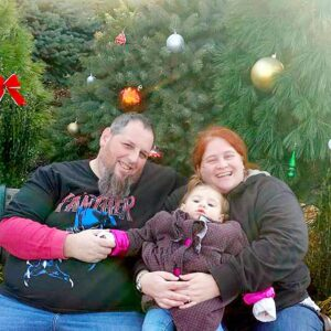 Little Emily helping her aunt and uncle choose the perfect Christmas tree
