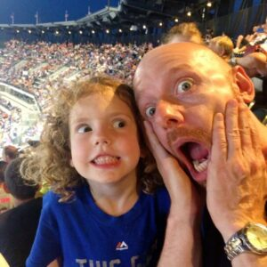 Making ridiculous faces with Jason's niece Delilah at a Mets game