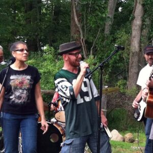 Jamming with Jason's cover band at a backyard BBQ