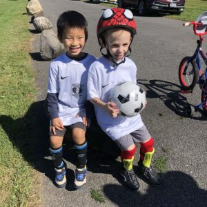 Matthew and his friends having fun playing soccer