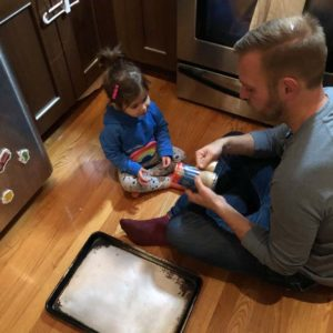 Mitch teaching Sienna how to cook