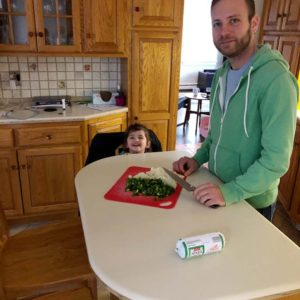 Mitch and Sienna chopping vegetables for dinner