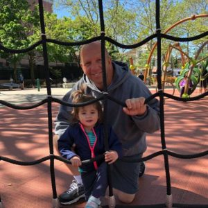 Sienna plays with Grandpa Tom at the playground