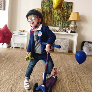 The birthday boy scooting off to school in New York City