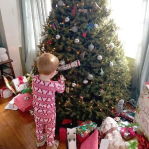 Sebbie adds some finishing touches to the Christmas tree in Connecticut