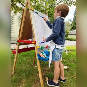 The artist inspired by nature. Painting in the garden in Connecticut