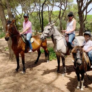 The three of us horseback riding in Portugal