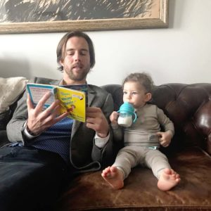 Sam reading a favorite Dr. Seuss story to Henry, the son of our close friends.