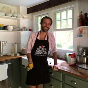 Sam preparing a summer BBQ in our kitchen in Connecticut while wearing an awesome apron from Eric's mom!