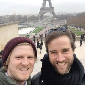 Eric meeting Sam at the Eiffel Tower while he's on a work trip in Paris.
